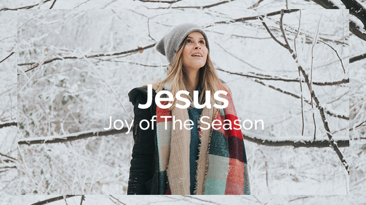 Woman looking around in the snowy woods with the text overlay of Jesus Joy of the Season, a bible reading plan