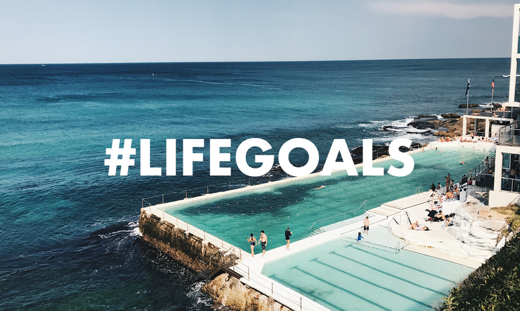 Pool resort on the each with text overlay of #lifegoals