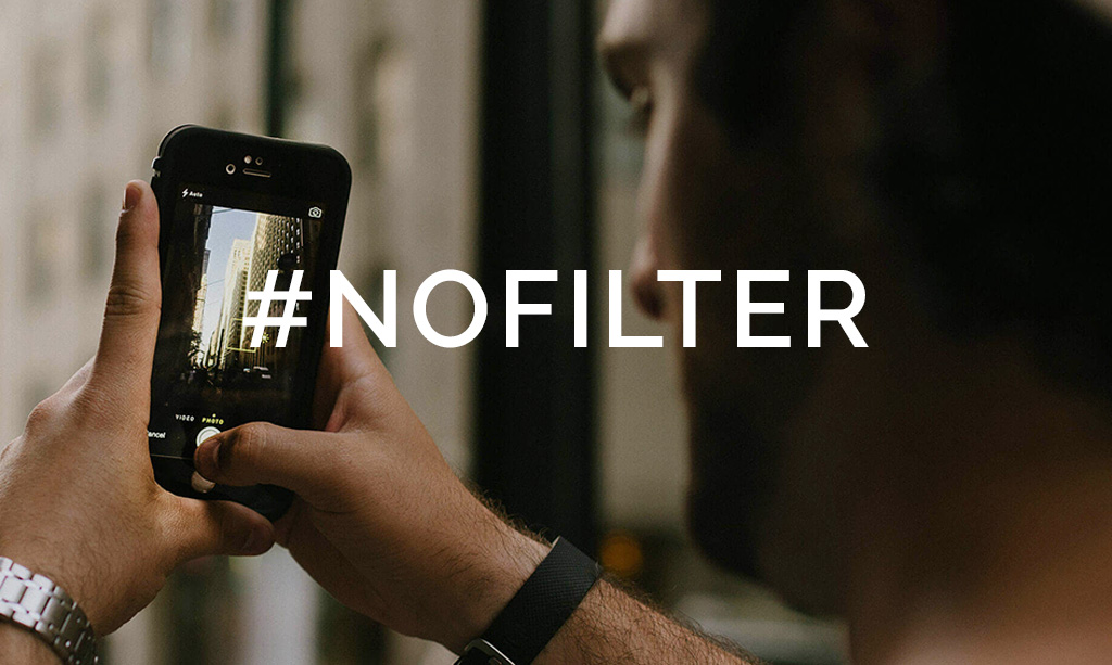 Person taking picture on phone with text overlay of #nofilter