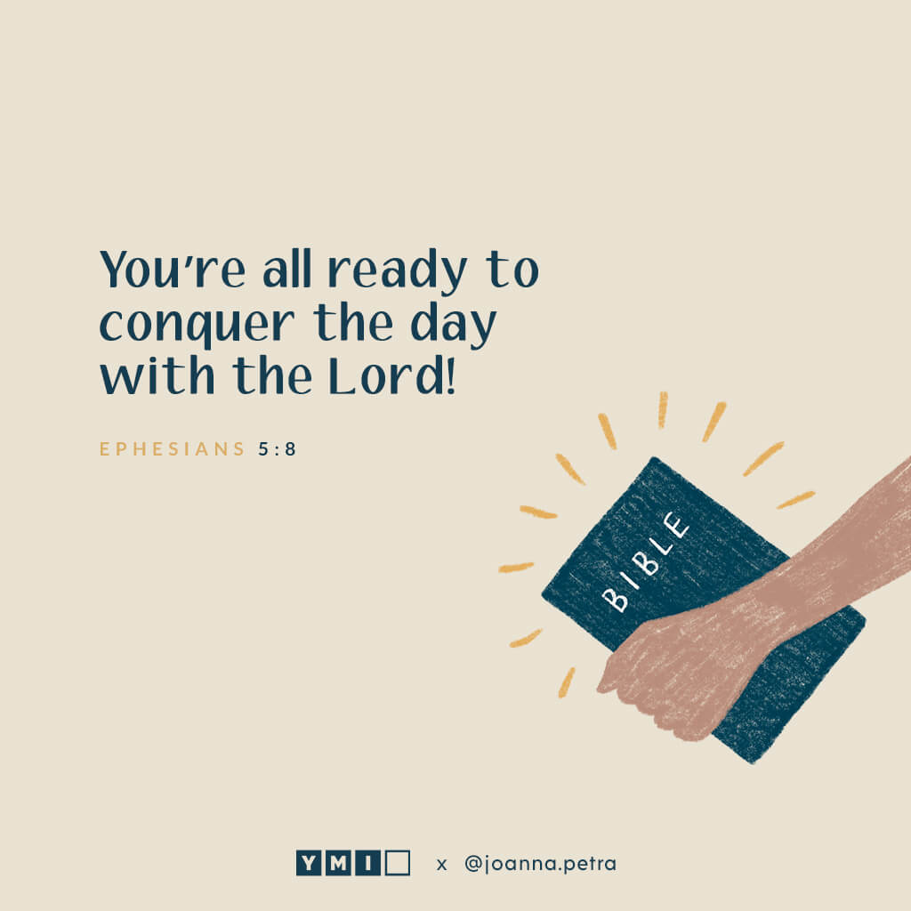 Hand holding bible with quote You're all ready to conquer the day with the Lord!