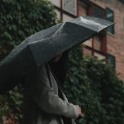woman holding umbrella in a rainy day