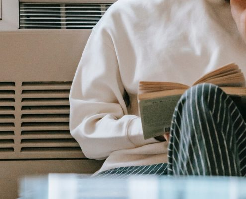 image of someone alone rest and reading a book