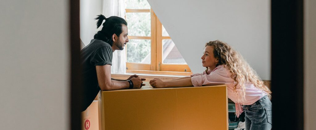 image of a couple in conversation at home