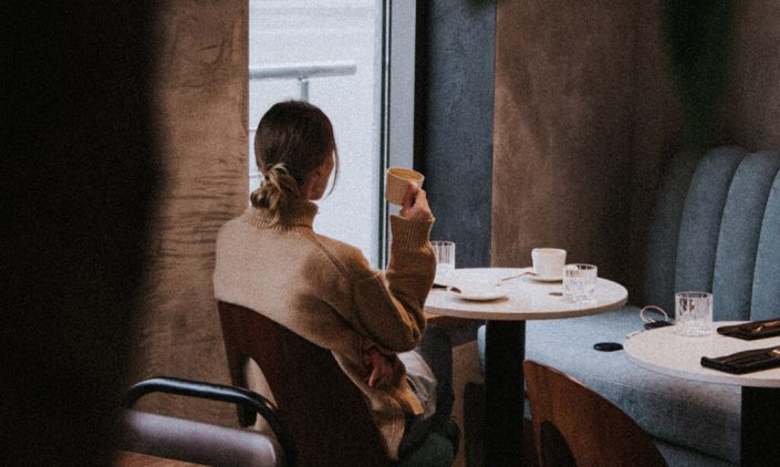 image of a woman in a cafe