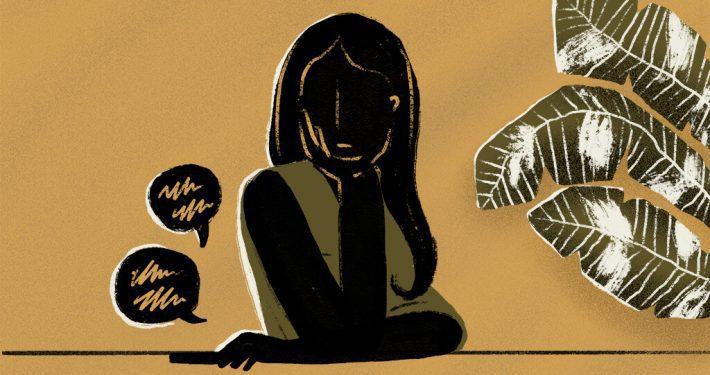 girl thinking beside plant