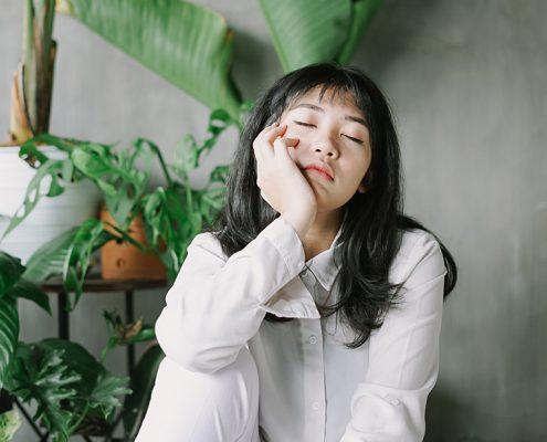 Image of asian girl looking sad