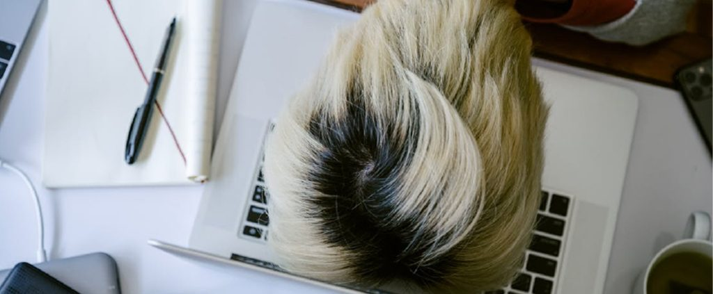 Exhausted asian girl with head on the keyboard