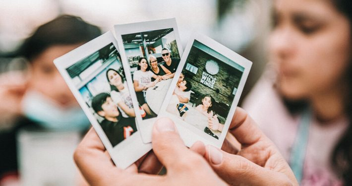 A hand holding some family photos
