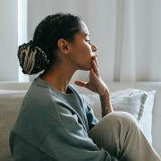 Image of a lady reflecting and thinking