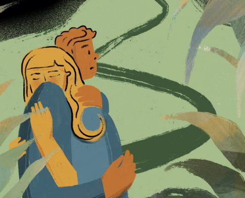 Image of a husband hugging an anxious wife
