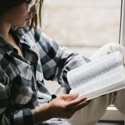 Image of a lady reading the Bible