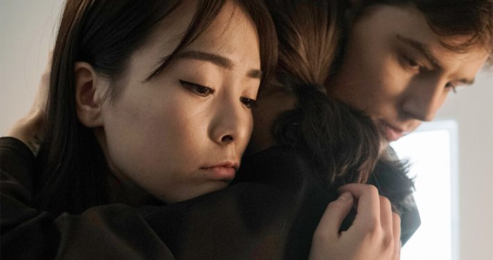 Image of friends comforting a friend grieving
