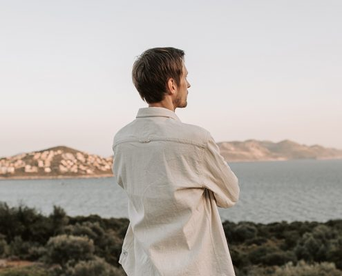 Image of guy looking out to a view