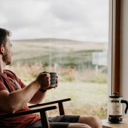 Image of a guy relaxing in front of a window