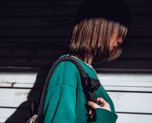 Image of girl with face covered in shadow
